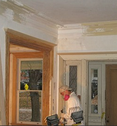 Before Pictures on Plaster Walls, Natural Wood Trim, and Original Doors